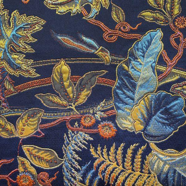 Bijzondere stof met bladeren in diverse kleuren, Ortega blauw