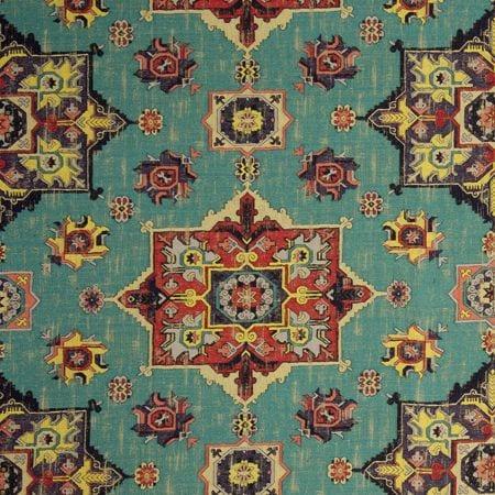 Kleurrijke op turkse tapijten lijkende stof Malatya aqua van Clarke and Clarke