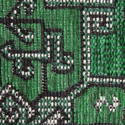 de diep groene kleuren in combinatie met zwart en beige creeëren een bijzondere stof#diep groene kleur#groene bank#groene fauteuil#oosterse stof#dutch seating company#made in holland