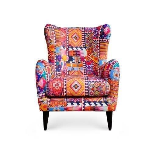 Deze Moorfauteuil in de kleurrijke stof Kelim van Dutch Seating Company
