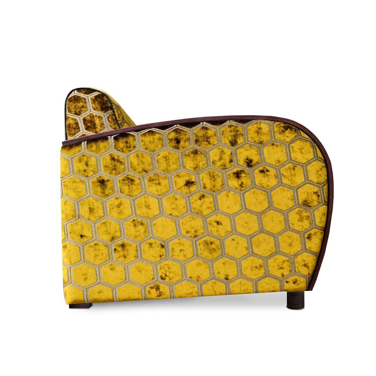 Art Deco Fauteuils. De rooker 02 fauteuil met de stof Manipur ochre van Designers Guild