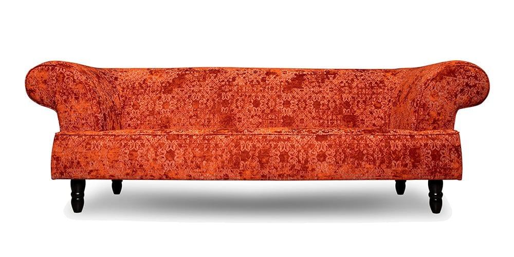 een rode chesterfield bank van dutch seating company