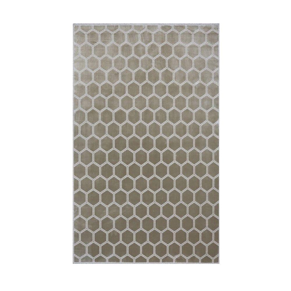 een vloerkleed van designers guild met een geometrisch dessin