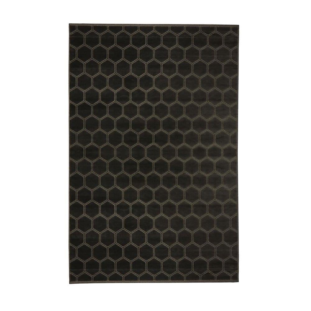 een donker bruin glanzend vloerkleed van designers guild