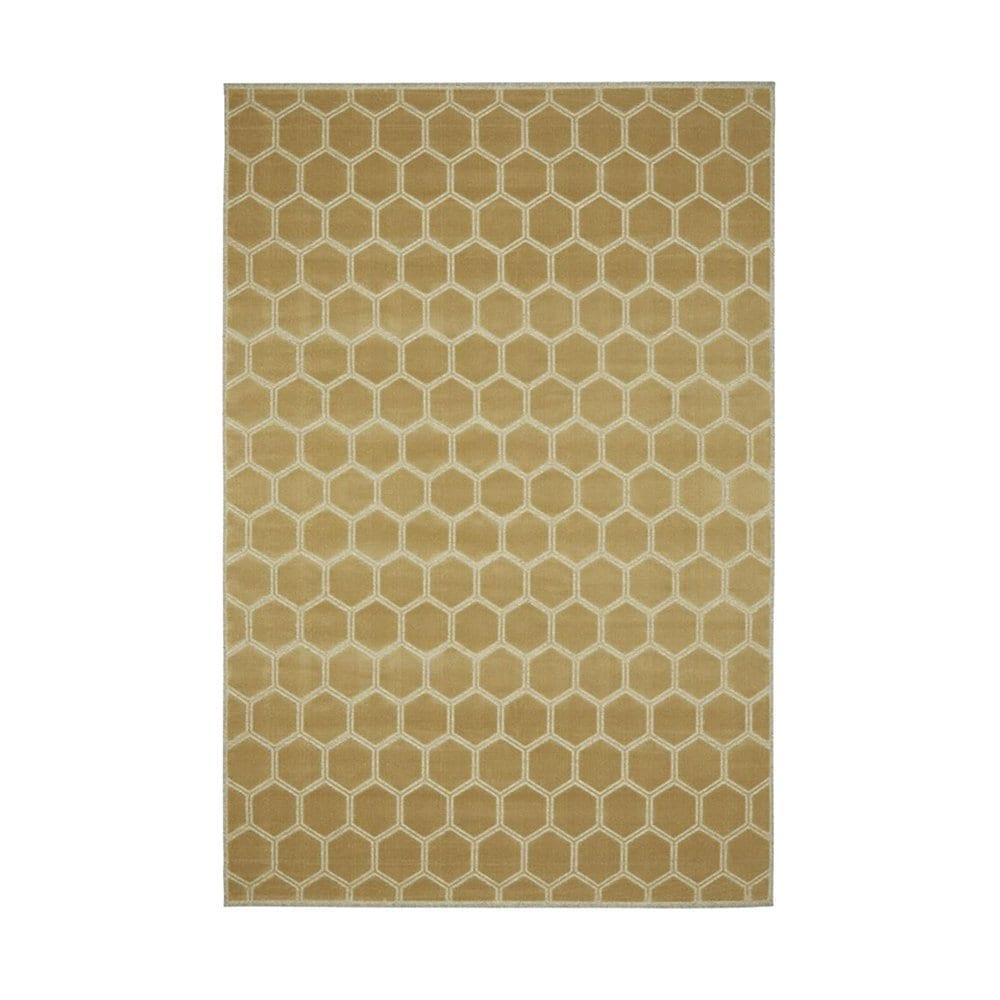 een licht geel gekleurd vloerkleed van designers guild