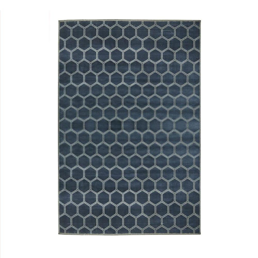 een blauw vloerkleed met een honingraat patroon